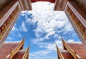 stock photo of framing a building  - Sky background look through the frame of building and roof thai style - JPG