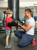 picture of boxing day  - Boy with personal trainer boxing in gym - JPG