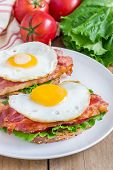 foto of tomato sandwich  - Open face sandwich with egg bacon tomato and lettuce - JPG