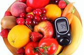picture of immune  - Glucose meter with fresh ripe fruits and vegetables lying on wooden plate concept of diabetes healthy food nutrition and strengthening immunity - JPG