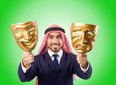 stock photo of arab man  - Arab man hypocrisy concept - JPG