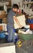 picture of yard sale  - Teenage Boy Clearing Garage For Yard Sale - JPG