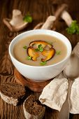 stock photo of mushroom  - Bowl of cream of mushroom soup with fried mushrooms - JPG