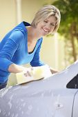 picture of car carrier  - Woman Washing Car In Drive - JPG