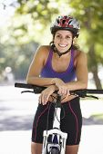 pic of riding-crop  - Woman Cycling Through Park - JPG