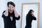 stock photo of shout  - Image of young woman with problems shouting loudly - JPG