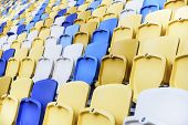 picture of grandstand  - Empty stadium seats with the raised lids - JPG
