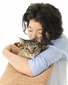 stock photo of snuggle  - A pretty young teen snuggling  - JPG