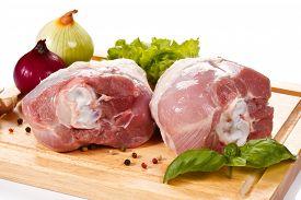 stock photo of turkey-hen  - Raw turkey legs on cutting board  - JPG