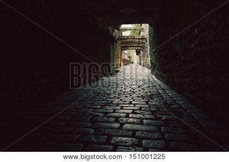 St. Catherine Passage - narrow paved street in the Old town of Tallinn Estonia
