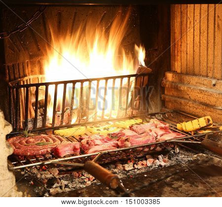 Hot Fire In The Fireplace In The Restaurant With Raw Meat