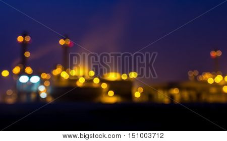 Bokeh blurred of oil refinery at a night