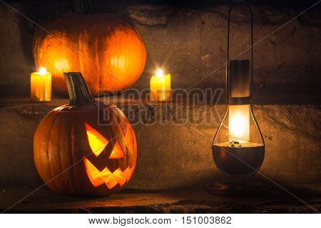 halloween pumpkin on stairs in basement. halloween background