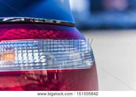 Luxury car rear light- closeup view, background