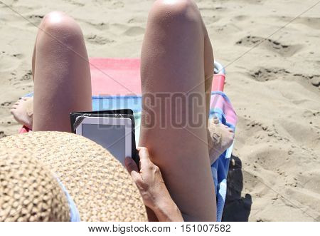 Long Legs Of A Beautiful Girl While Reading An Ebook