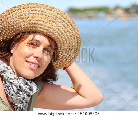 Beautiful Forty Year Old Woman With Straw Hat