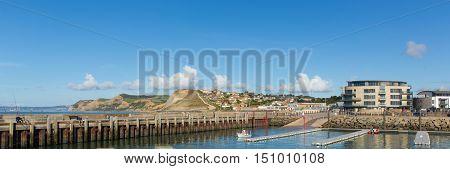 West Bay harbour Dorset uk panoramic view to Golden Cap