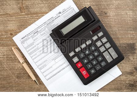 Calculator and tax form which confirms the payment of the tax in the USA