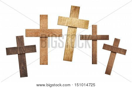 Set of differt size wooden crosses on white background.