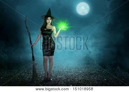 Beauty Asian Witch Woman With Magic Spell And Flying Broom