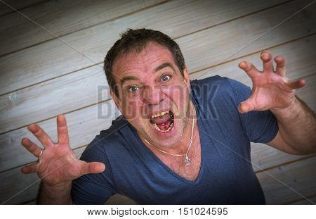 Aggressive angry man with a red face