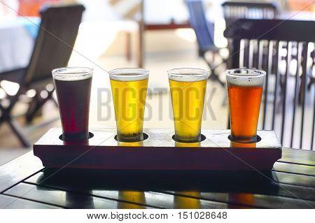 Four sorts of beer. Beer tasting. Ale porter lager pilsner