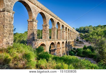 Two level archade of roman aqueduct near Tarragona, summer Spain