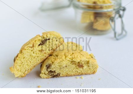 Homemade raisins cookies on white baclground. Jar with freshly baked raisin cookie. Healthy breakfast raisins cookies. Tasty cookies for an afternoon snack. Selective Focus.