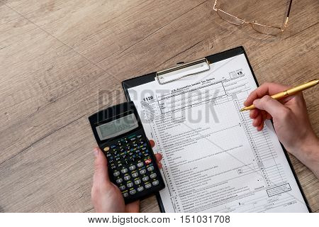 Man filing tax form 1120 in office