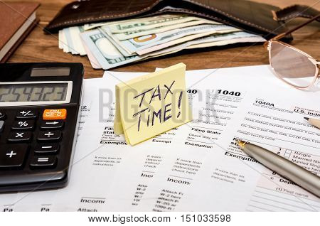 Time for taxes with money on desk