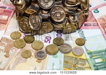 Piggybank coins and euro bills for background