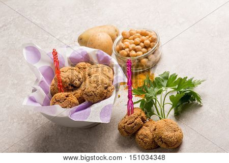 vegetarian meatballs with potatoes chickpeas and curry