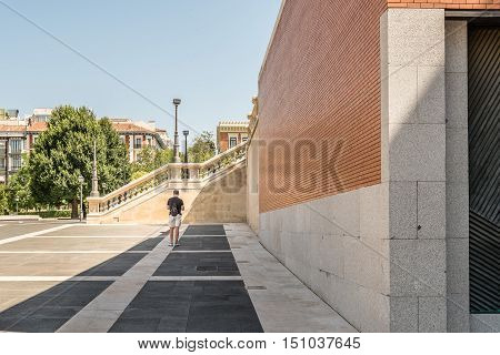 Madrid Spain - July 03 2016: Prado Museum. Man walking on new wing of Museum on a sunny day. It is the main Spanish national art museum. It features one of the world's finest collections of European art.
