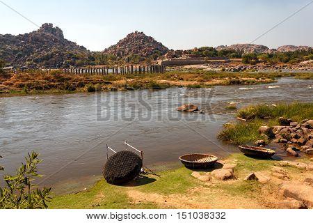 Coracle boats in Tungabhadra River Hampi ruins India