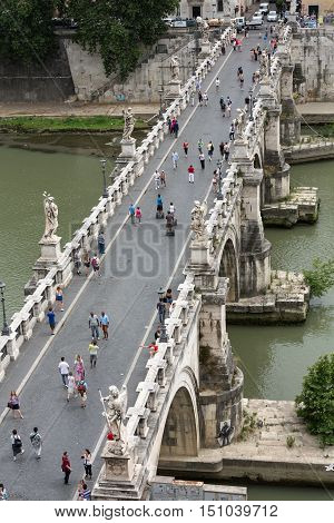 ROME, ITALY - JUNE 12, 2014: People on the bridge of Sant'Angelo in Rome Italy