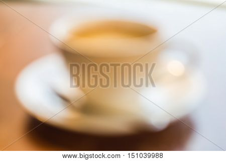 Americano coffee cup in blur and de-focus.