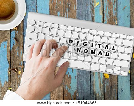 Concept of Digital Nomad words on the button of the keyboard.