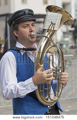 TIMISOARA ROMANIA - SEPTEMBER 25 2016: Singer ethnic German from Banat Romania playing at trombone with occasion of Festival of ethnic groups