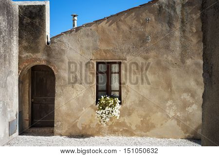External view of a typical house of Populonia (Tuscany, Italy), ancient etruscan village along the shores of the Tyrrhenian Sea (knew as Etrurian Coastline).