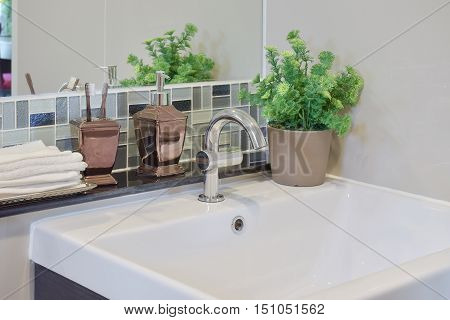 Faucet and lavatory with toothpastes liquid soap bottle