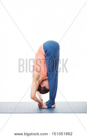 Woman doing Ashtanga Vinyasa Yoga asana Padangushthasana - standing forward bend hand to toe pose posture isolated on white background