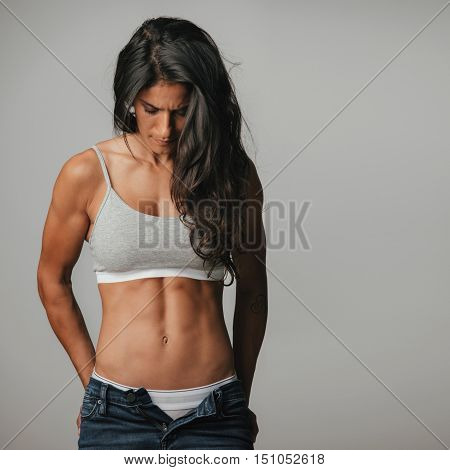 Powerful Athletic Woman Wearing Unzipped Jeans