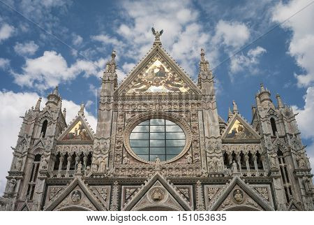 Siena, Italy, Tuscany: view of the facade of the Cathedral of Santa Maria Assunta in Siena (Tuscany, Italy), built in Italian Gothic Roman style in the XI Century.