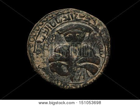 Ancient Islamic Copper Coin Isolated On Black