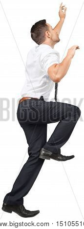 Portrait of a Businessman Climbing an Invisible Wall