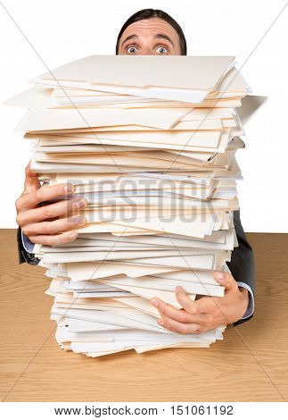 Portrait of a Surprised Employee Behind a Stack of Documents