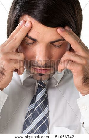 Portrait of an Exhausted / Meditating / Having Headache Businessman
