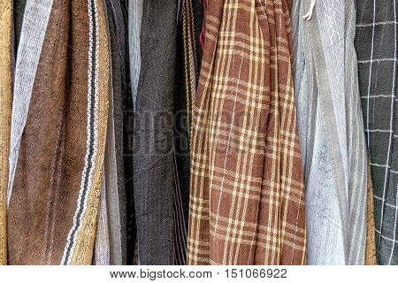 Rough textured fabric and textiles of pastel colors and checkered pattern for sale in the most famous market in Chinatown district Bangkok Thailand