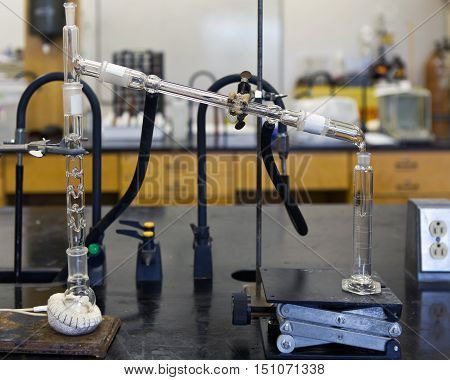 Ethanol chemical distillation with heating mantle in a laboratory.