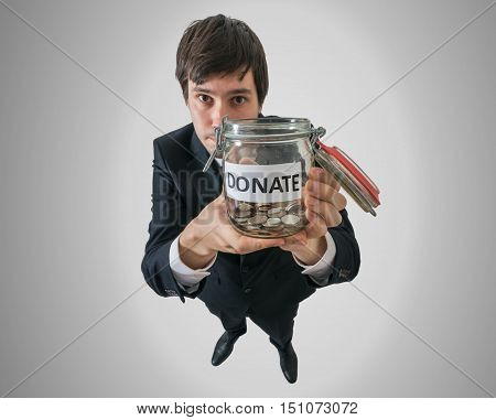 Businessman Holds Jar With Coins And Asking For Donation.